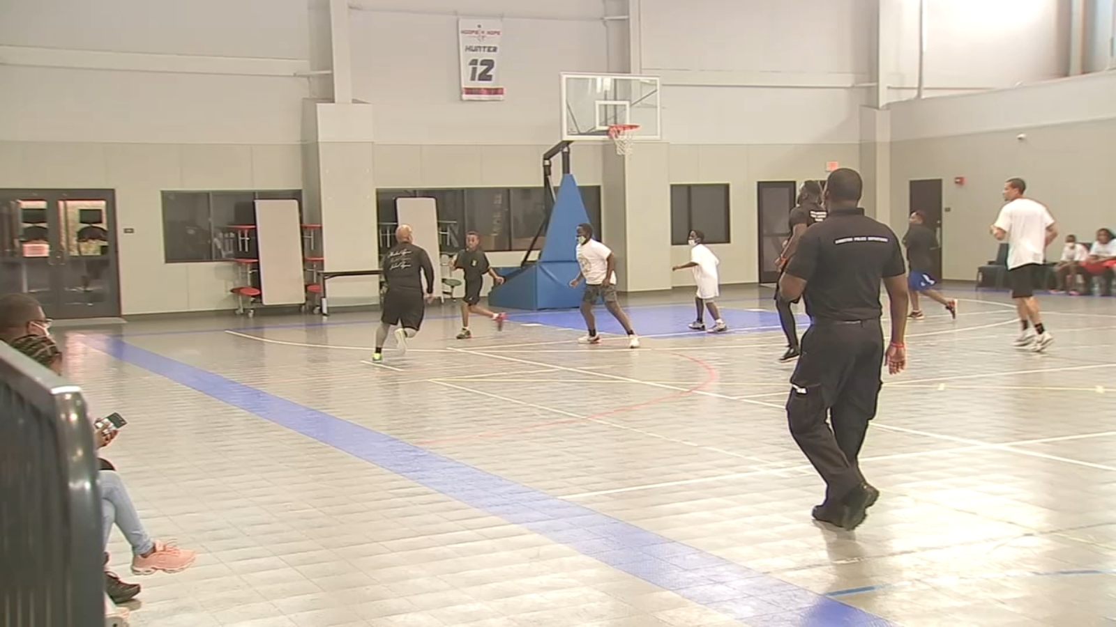 Houston law enforcement work to build health relationships with kids through basketball