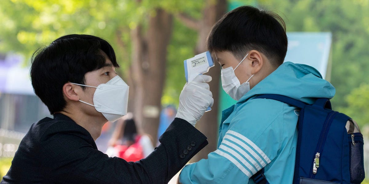 56 coronavirus cases were linked to a Starbucks in South Korea. But employees who were wearing masks didn't get infected.