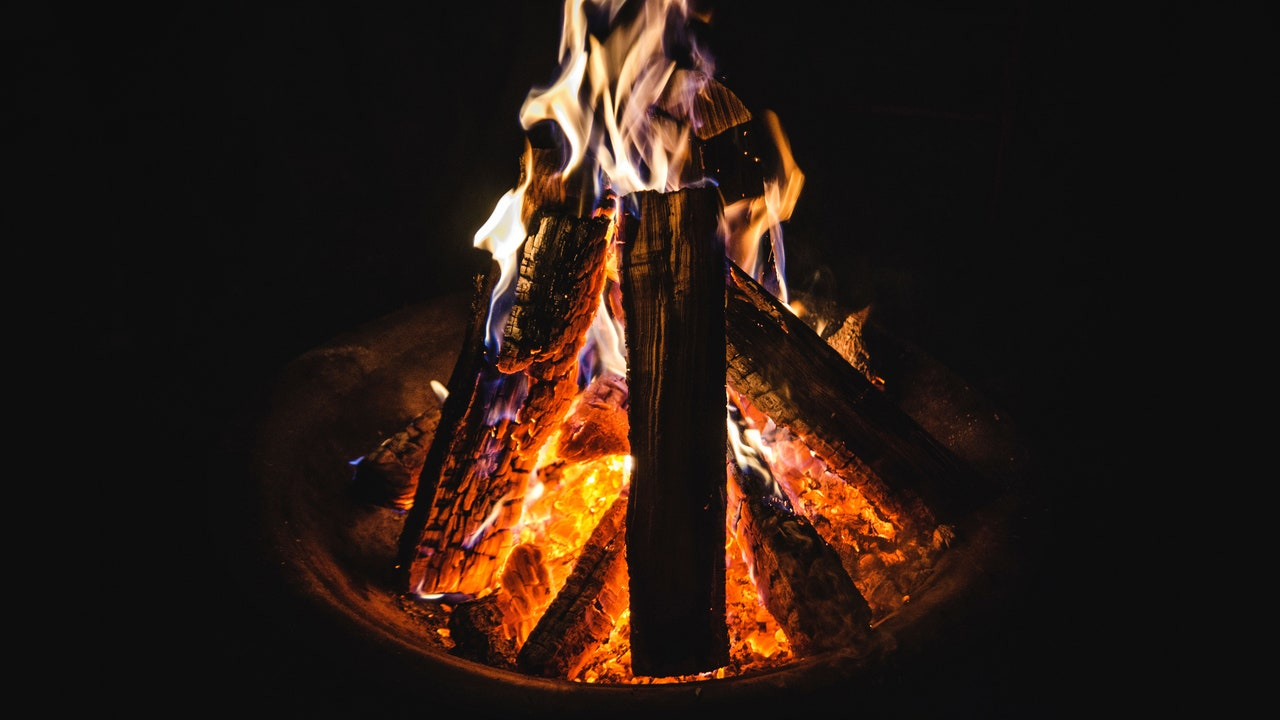 A Fire Pit Is the Key to Cold Weather Outdoor Hangs